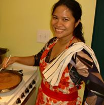 Noy Thrupkaew cooking and smiling